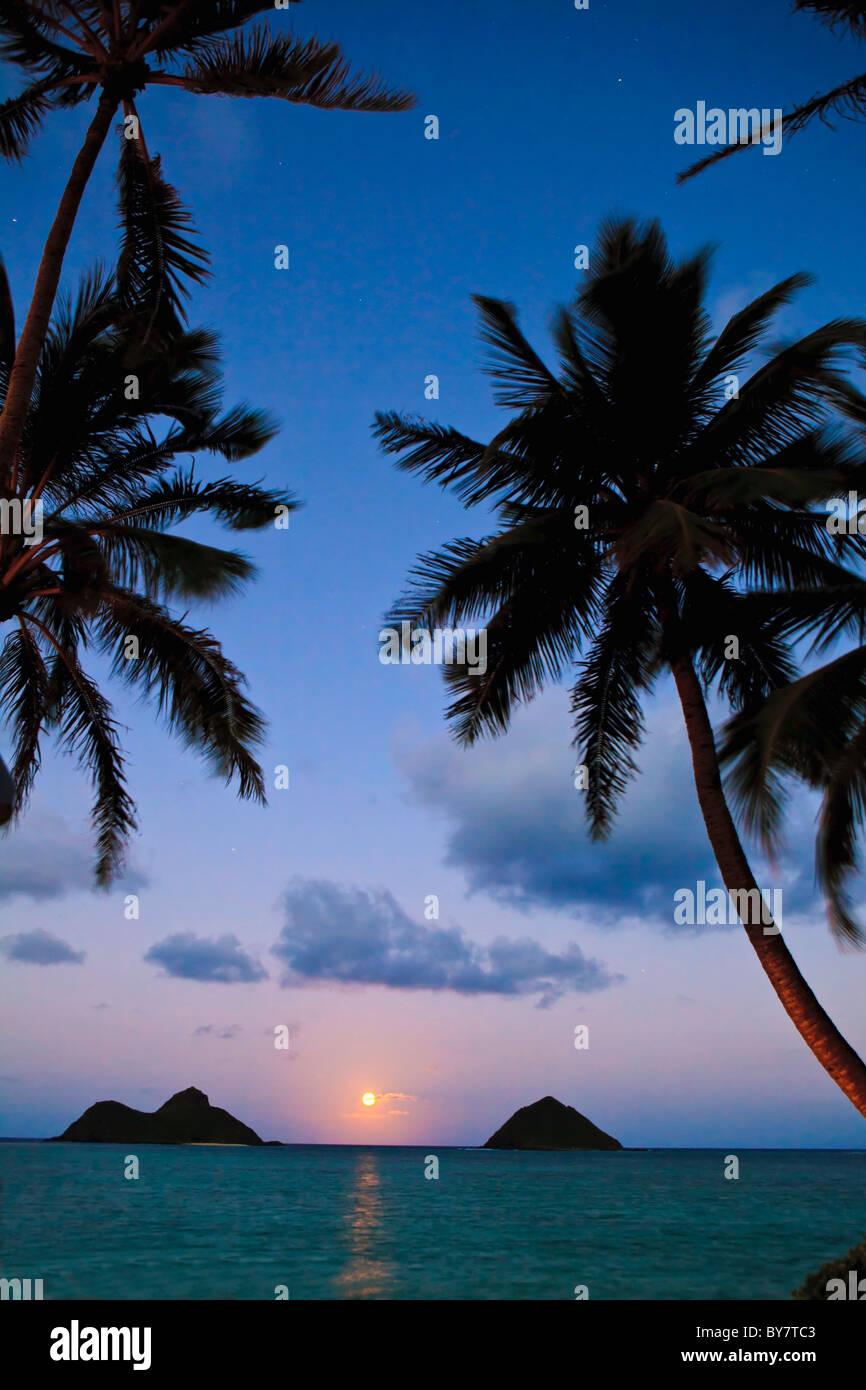 pacific moonrise between the mokulua islands in oahu, hawaii Stock Photo