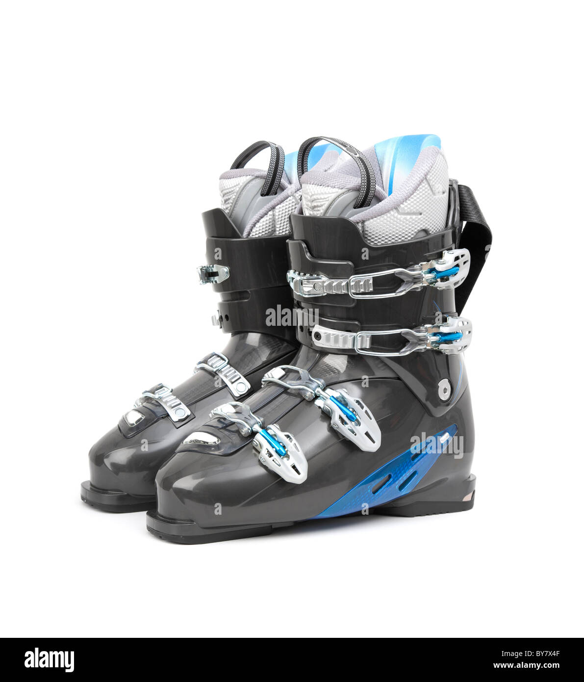 Brand new pair of ski boots isolated on white background - Stock Image