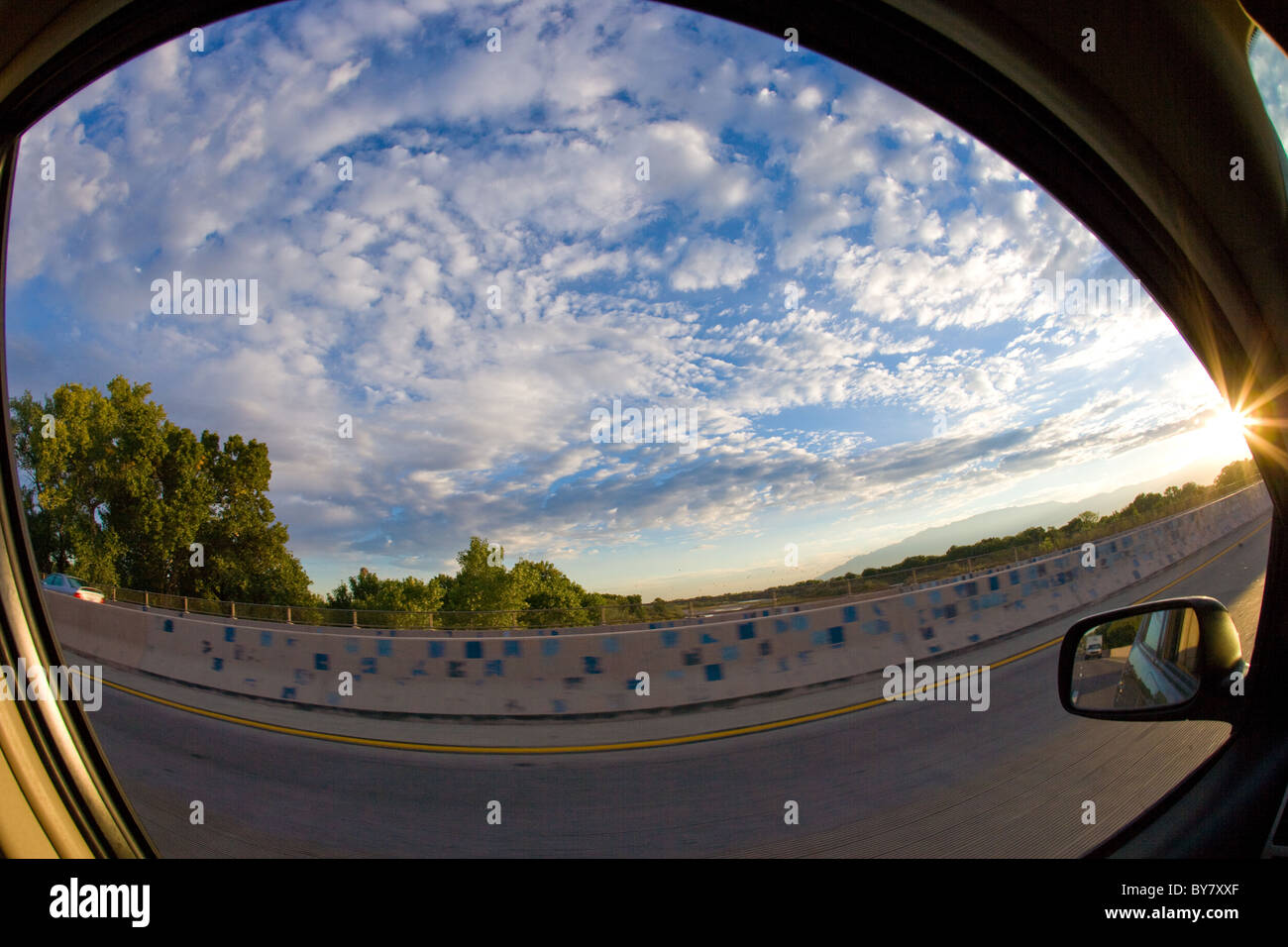 blue sky of New Mexico, USA, as seen through car window, fisheye lens - Stock Image