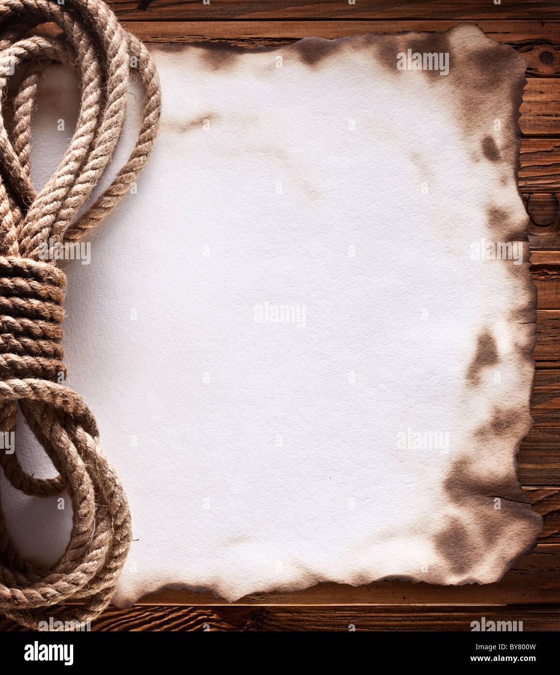 Image of old paper on wood background. - Stock Image