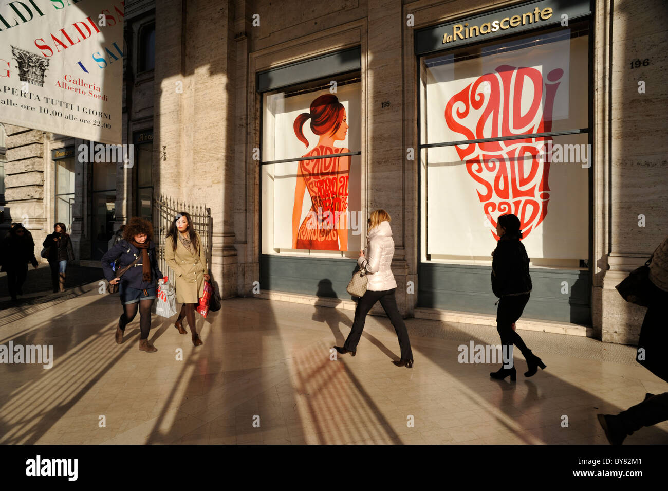 italy, rome, galleria alberto sordi, galleria colonna, shop window, sales, people shopping - Stock Image