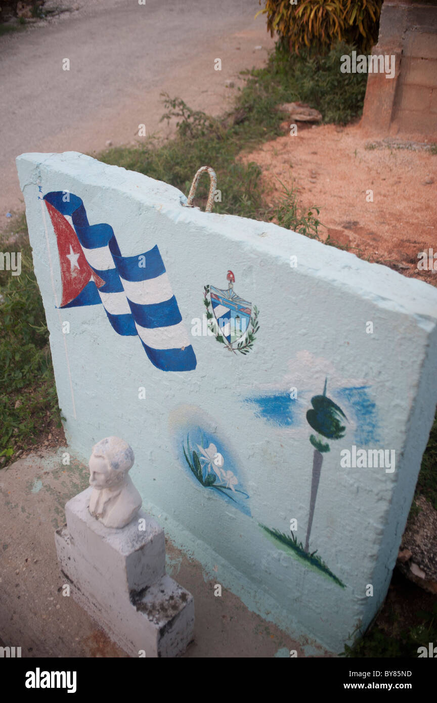 Sculpture in tribute to Jose Marti the Cuban revolutionary with cuban flag and blue wall. - Stock Image