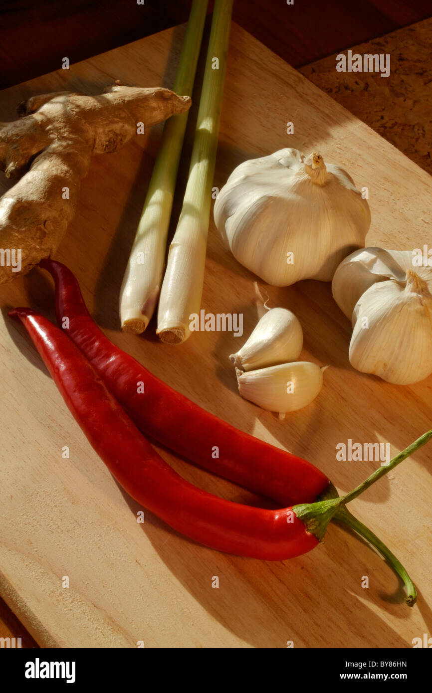 Garlic, chilies, lemon grass and ginger, some of the basic ingredients of far Eastern cooking - Stock Image