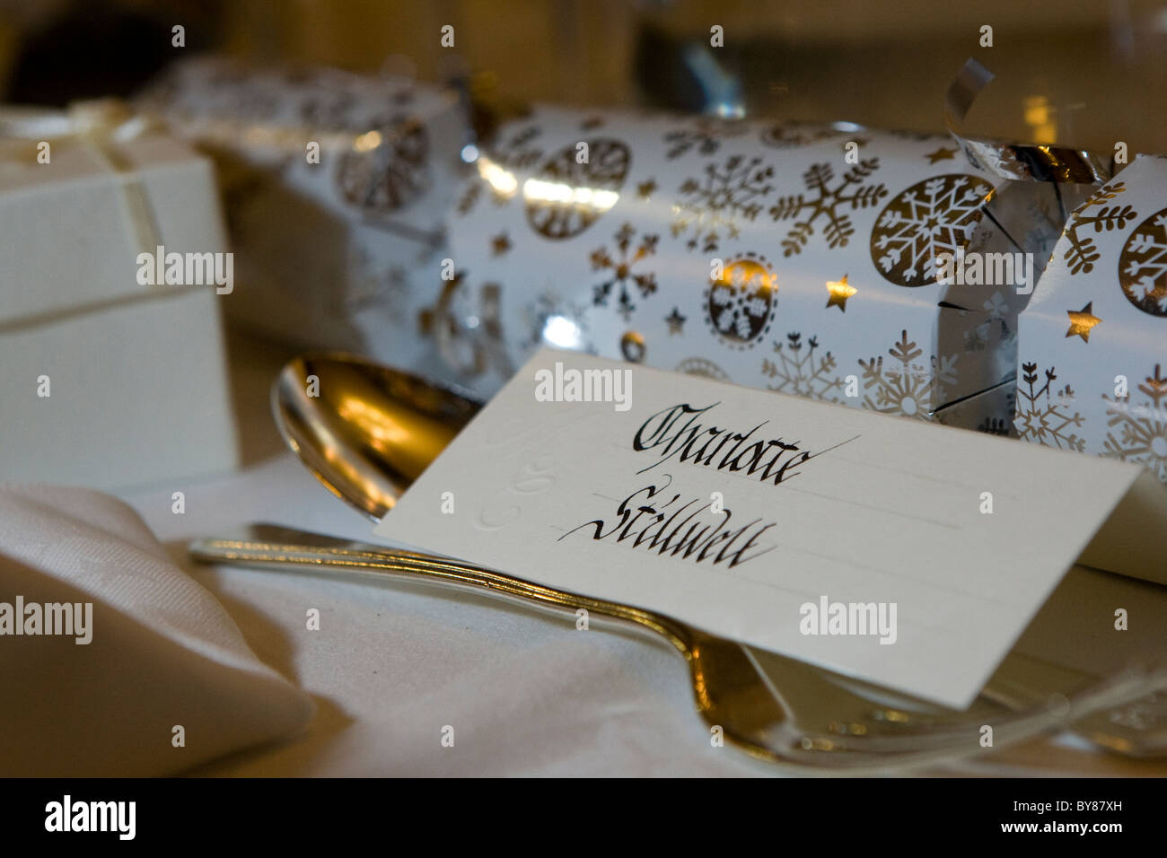 Calligraphy, cracker and cutlery - Stock Image