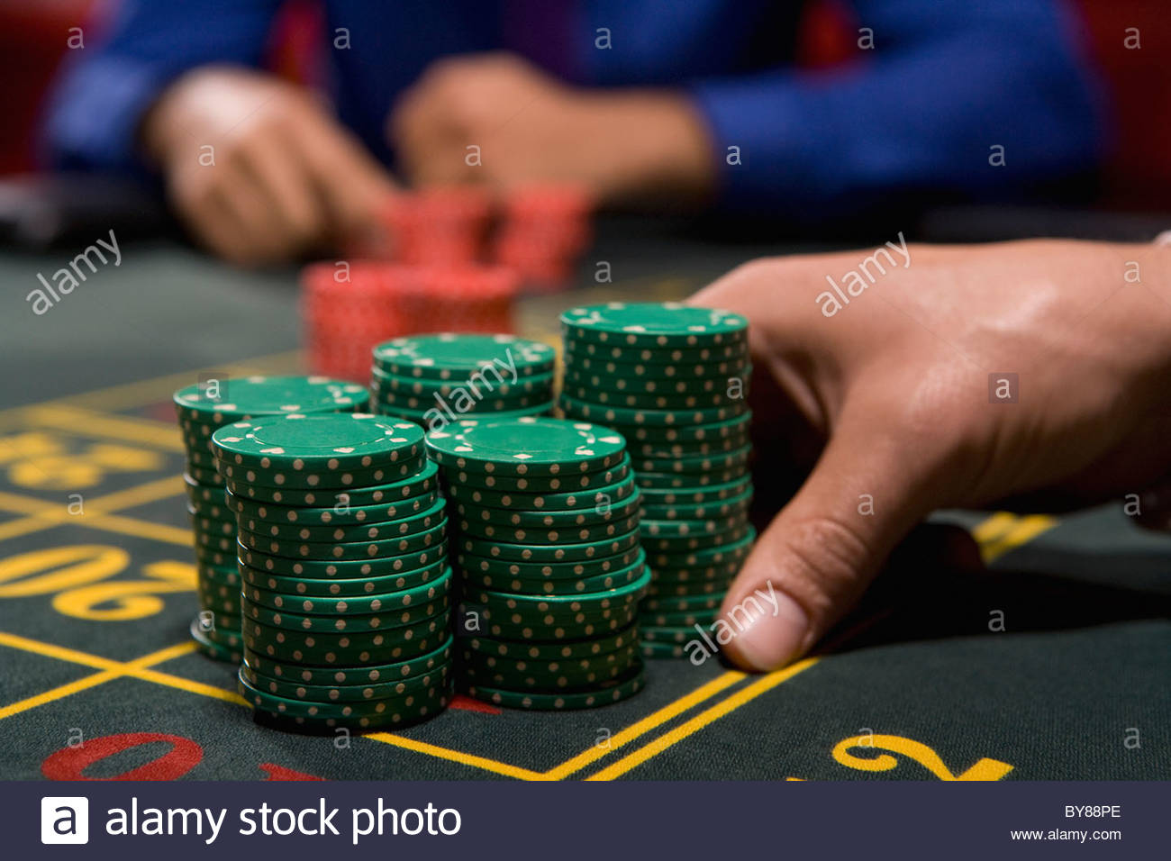 Hand betting gambling chips - Stock Image