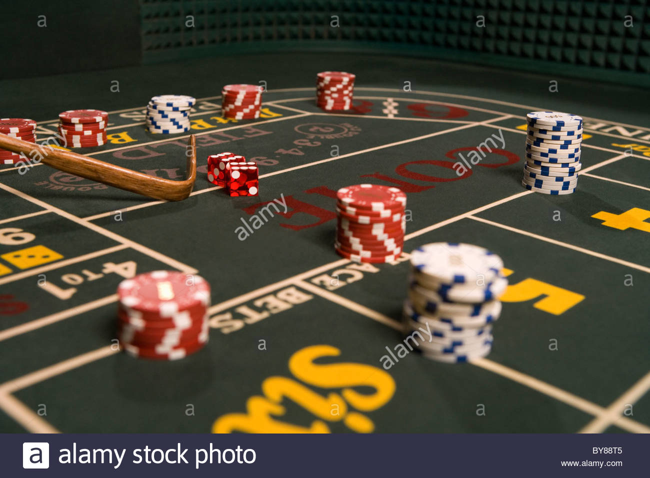 Dice and gambling chips on craps table Stock Photo