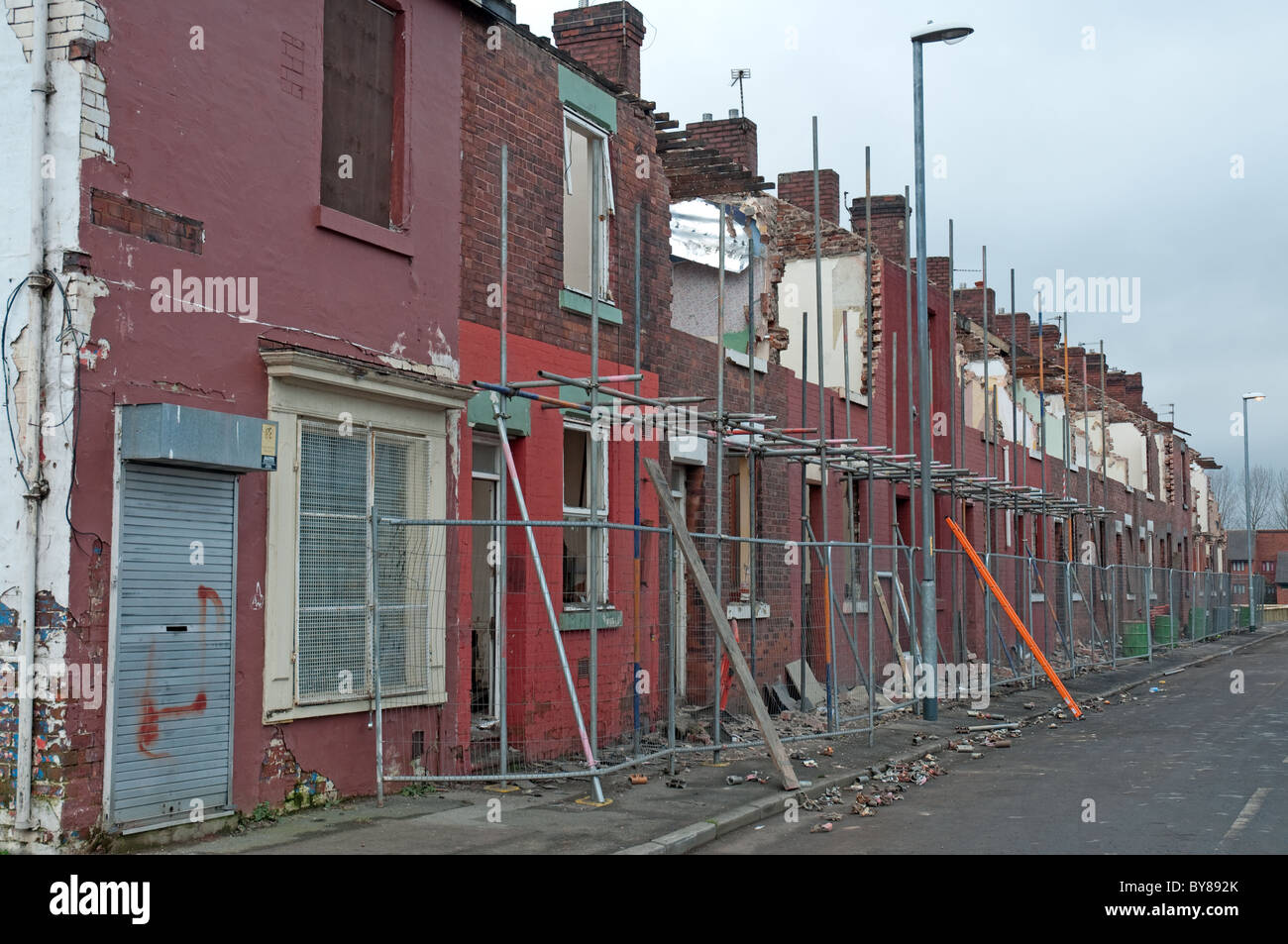 Partially demolished row of terraced houses.Openshaw  district of Manchester,UK. - Stock Image