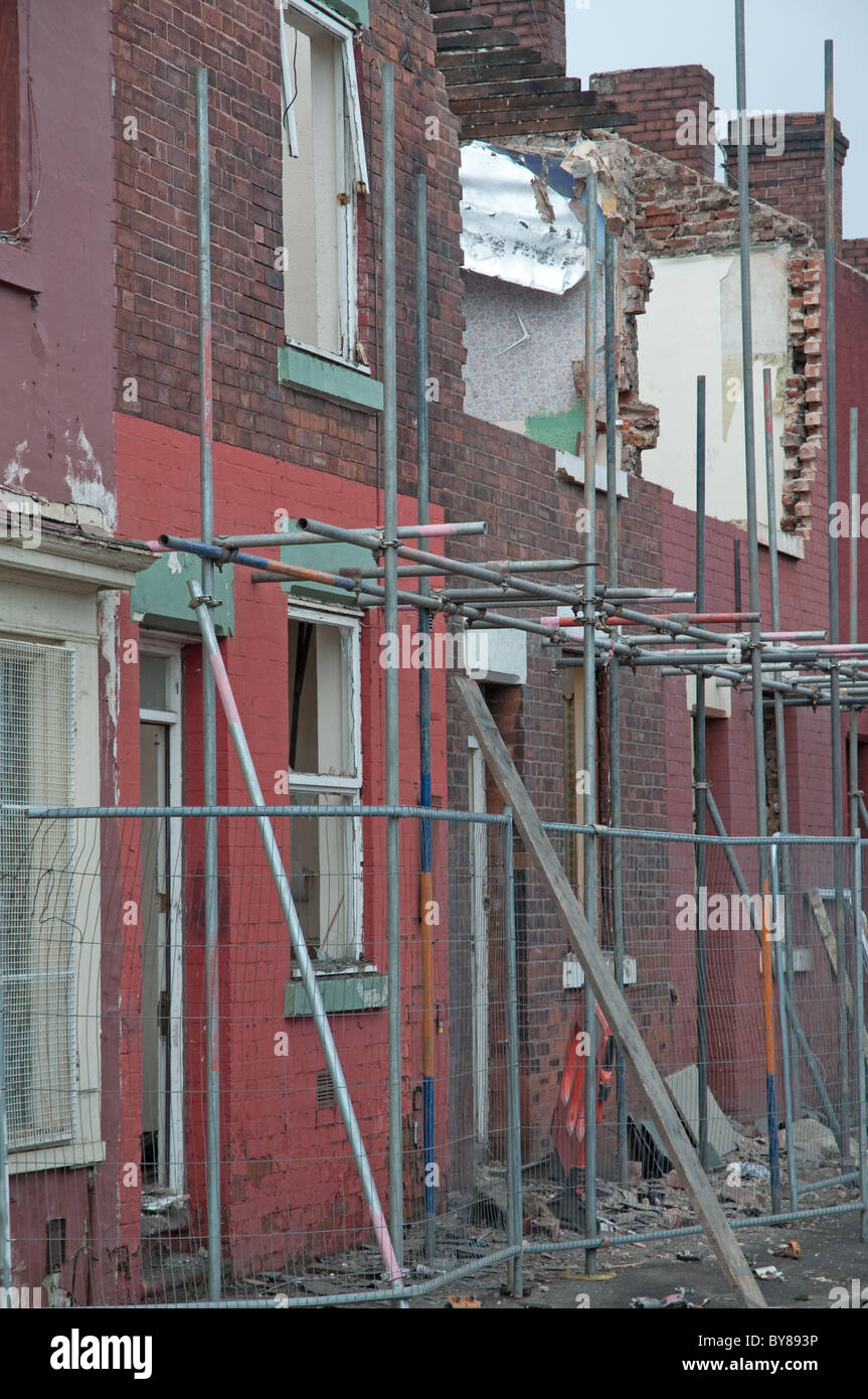 Partially demolished row of terraced houses.Openshaw  district of Manchester,UK - Stock Image