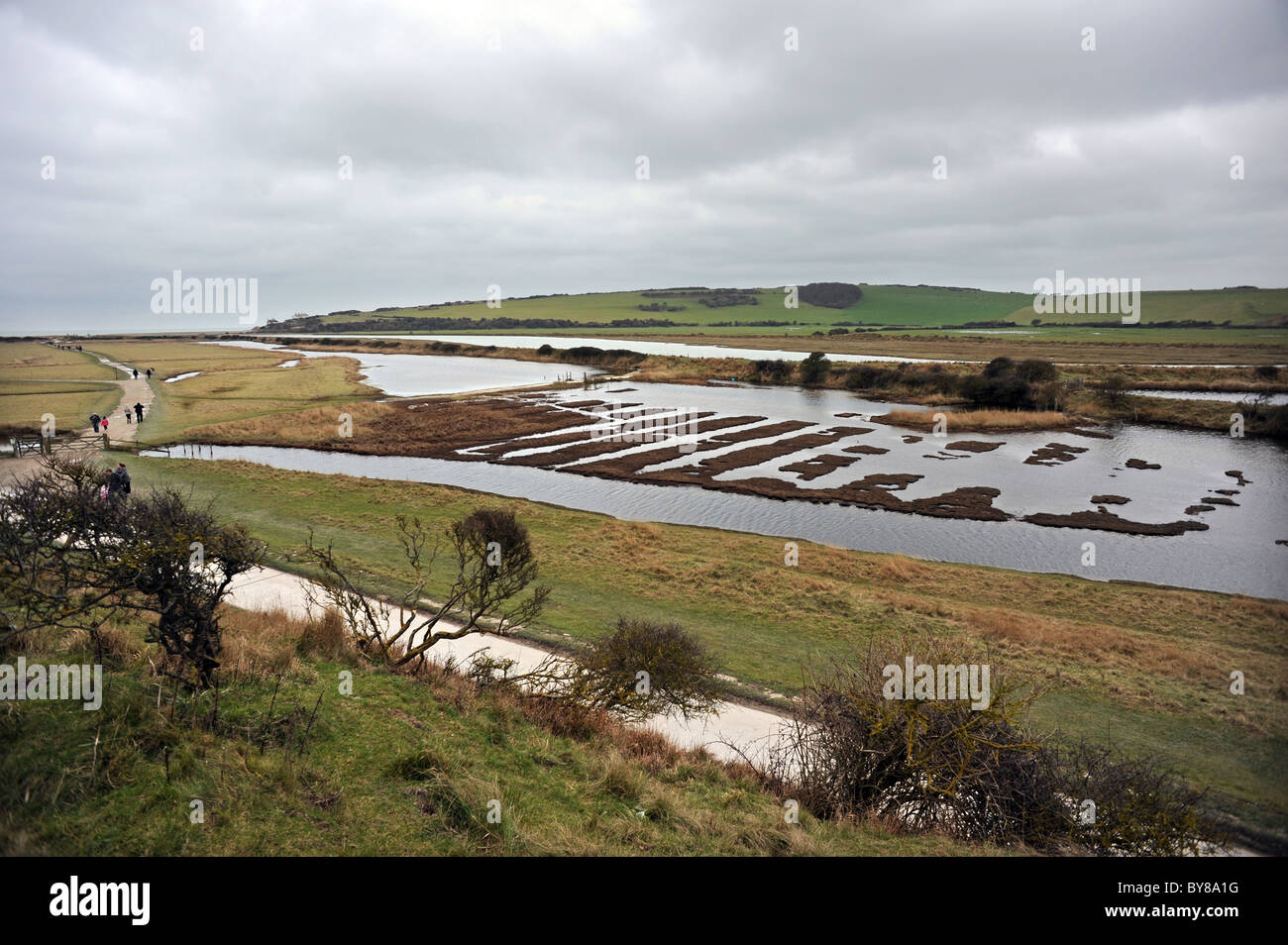 Cuckmere Haven is an area of flood plains in Sussex  where the river Cuckmere meets the English Channel Stock Photo