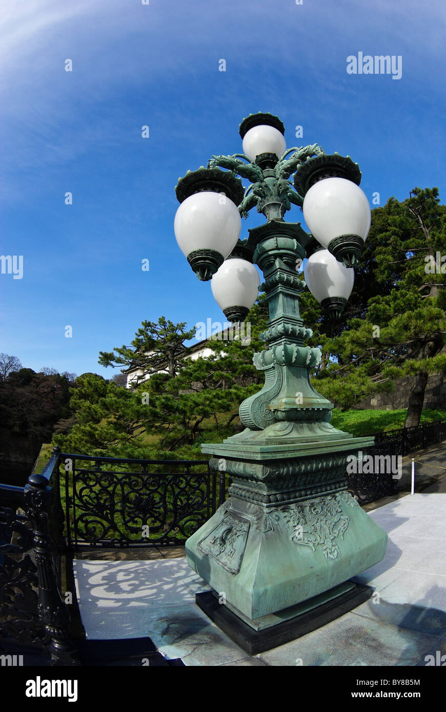 Lantern on Nijubashi Bridge with Fujimi-yagura in the background, Tokyo Imperial Palace, Tokyo, Japan, Asia - Stock Image
