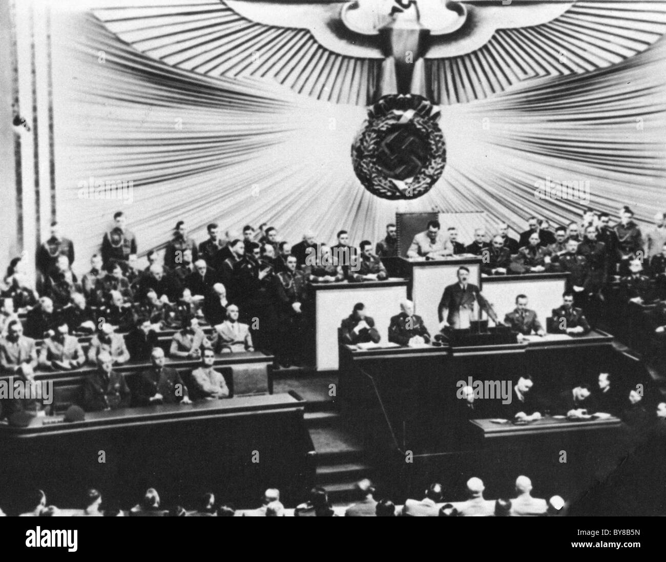 ADOLF HITLER addresses the Reichstag with Goering in light suit presiding behind him - Stock Image