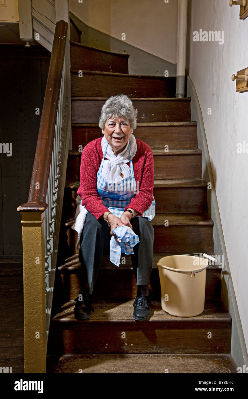 Old Woman Finished Cleaning Sitting On Steps Stairs Stock