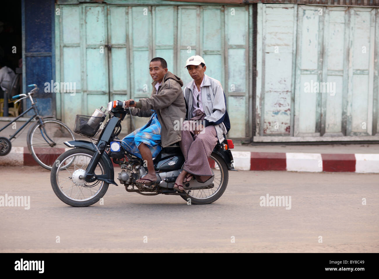 Two man on a bike - Stock Image