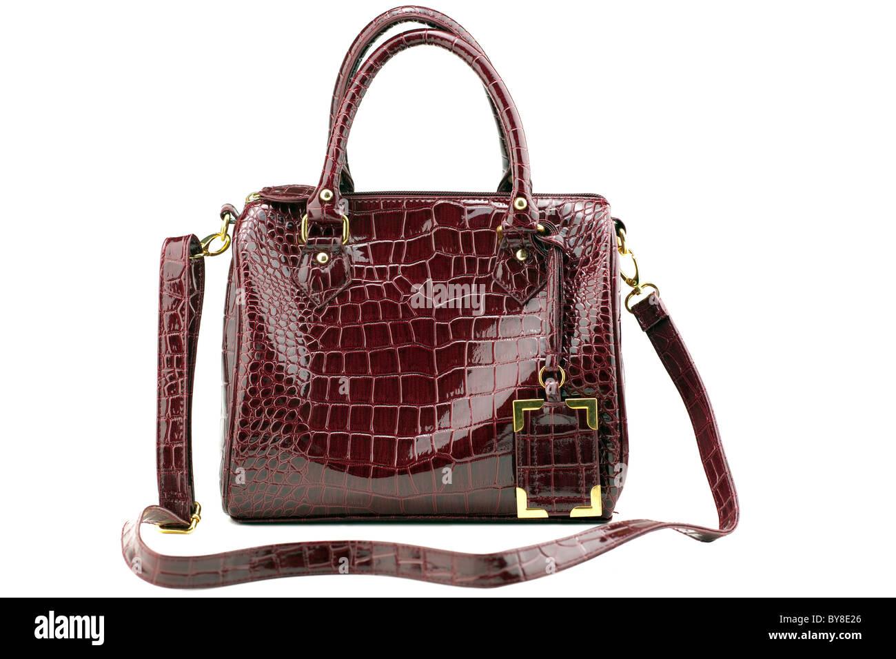 maroon imitation crocodile leather handbag - Stock Image