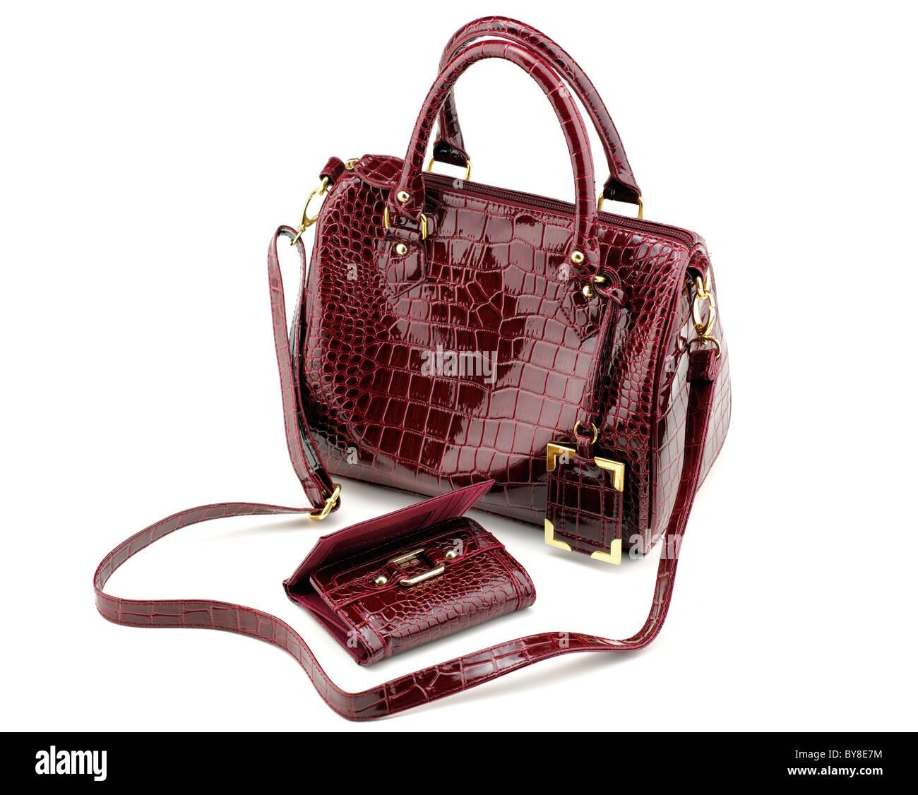 maroon imitation  leather handbag and matching purse - Stock Image