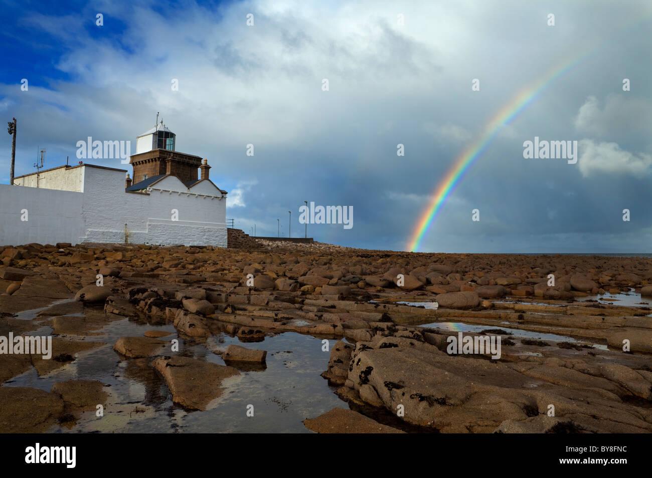 Rainbow Over the Lighthouse at Doonbeg Point, The Mullet Penninsula, County Mayo, Ireland - Stock Image