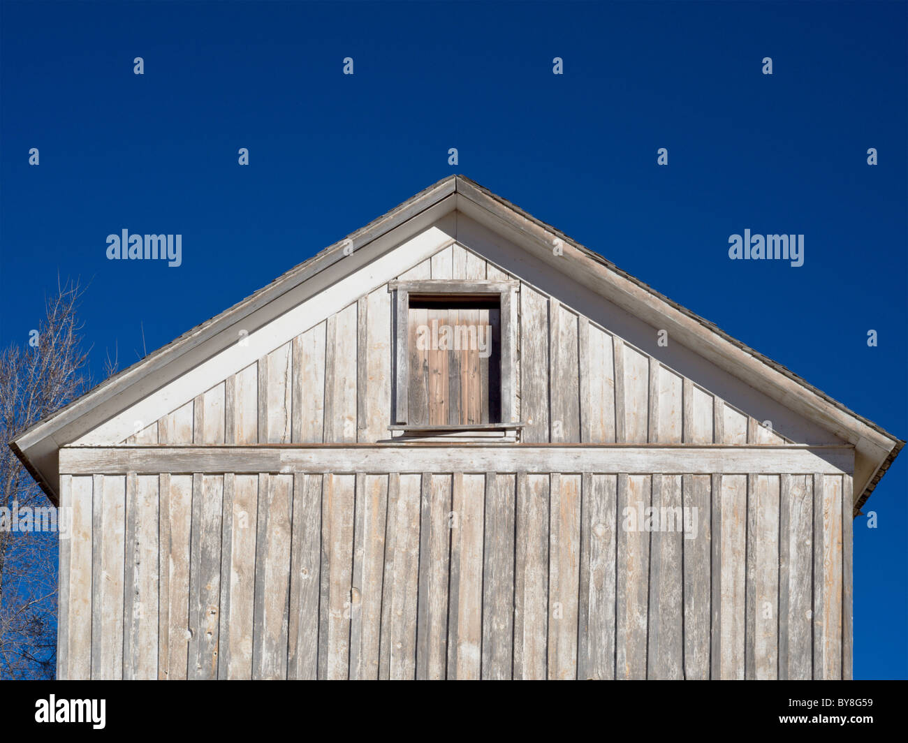 An old wooden building stands under a blue sky, on the Mescalero American Indian reservation, New Mexico. Stock Photo