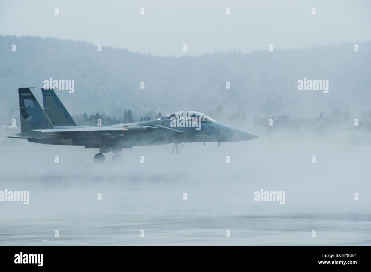 Jet fighter on runway with fog - Stock Image