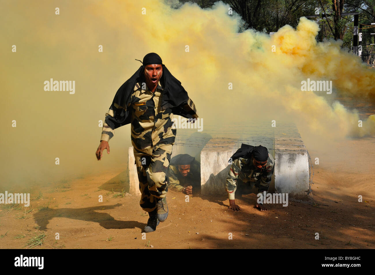 Three Indian soldiers doing commando training - Stock Image