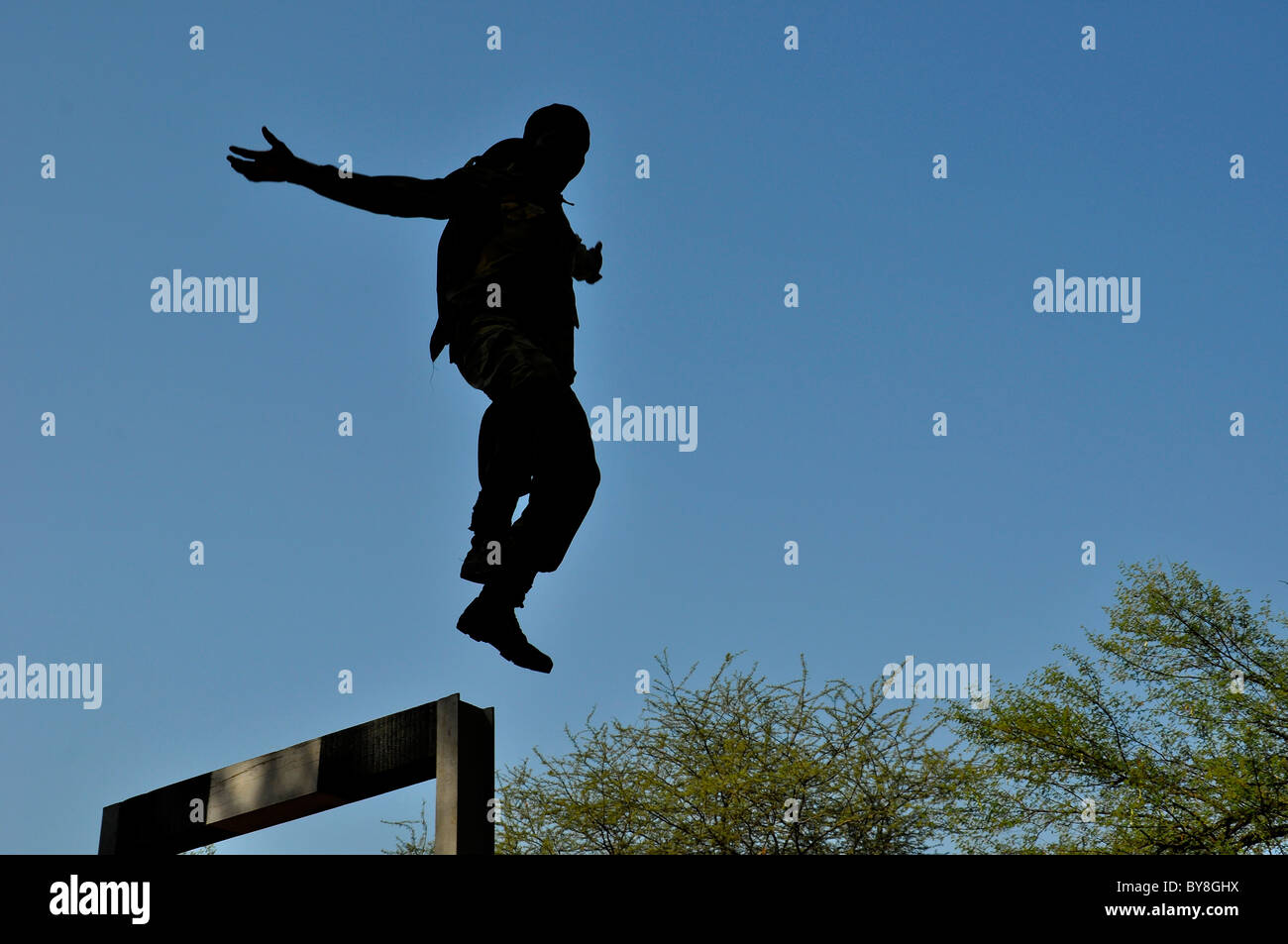 An indian Commando jumping form an obstacle - Stock Image