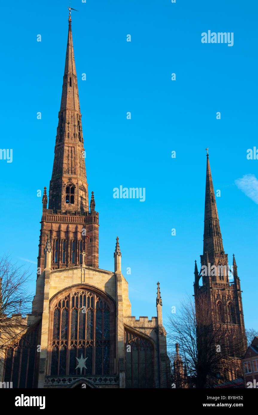 Holy Trinity Church spire in the foreground with the old Coventry Cathedral (St Michaels) to the rear. West Midland, Stock Photo