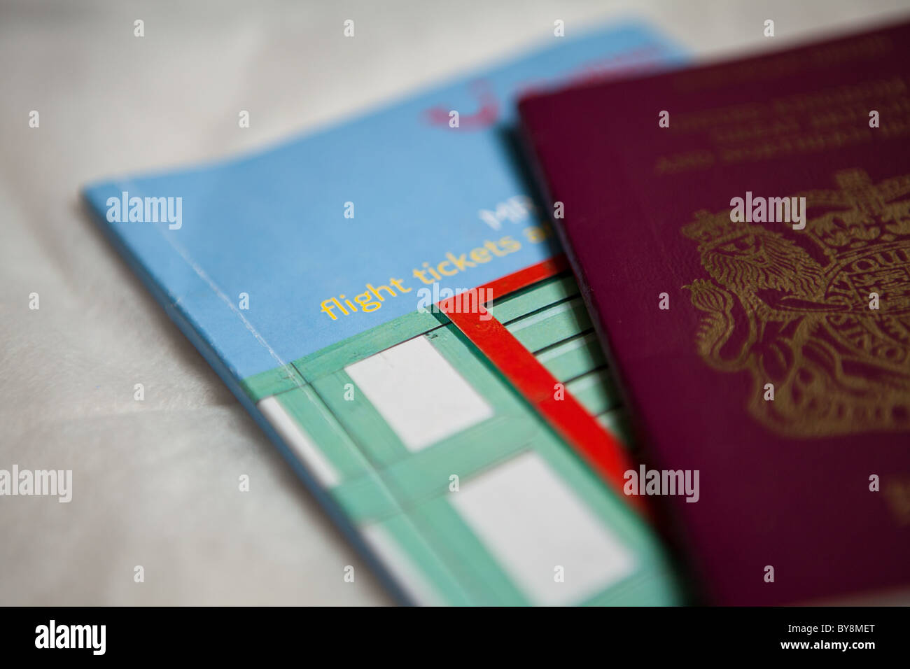 British passport on a travel guide book - Stock Image