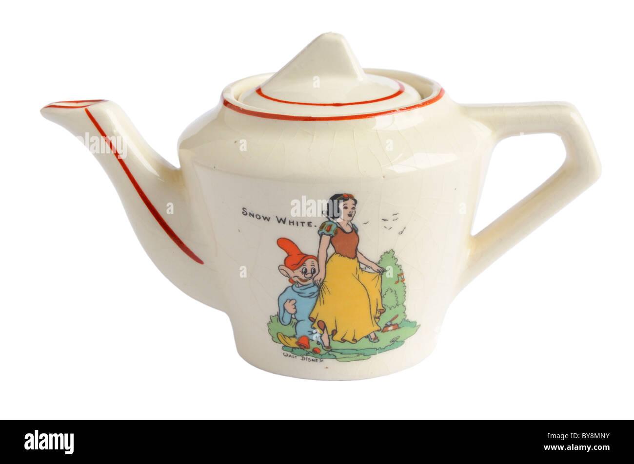 A 1930's Snow White doll's tea pot - Stock Image