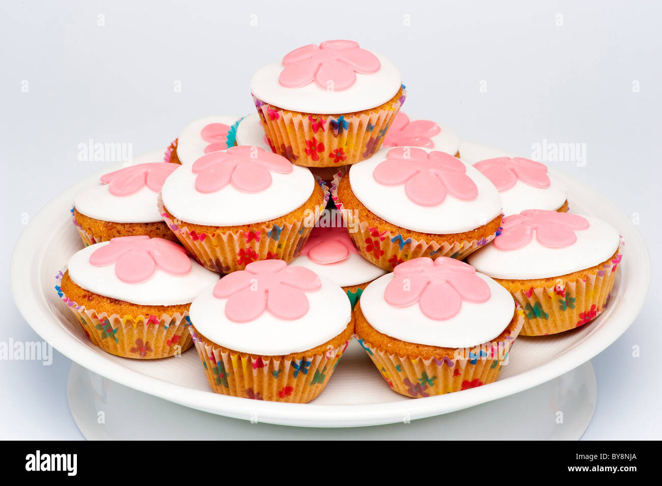 White Iced Buns With Pink Icing Flowers Stock Photo 33998674 Alamy
