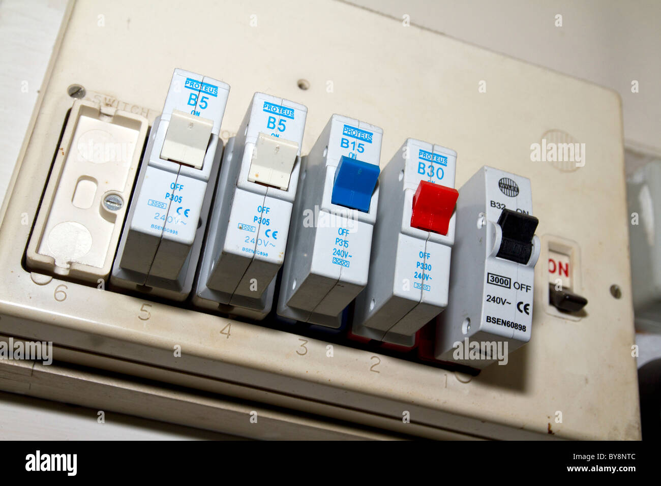 old electric fuse box in a london house - stock image