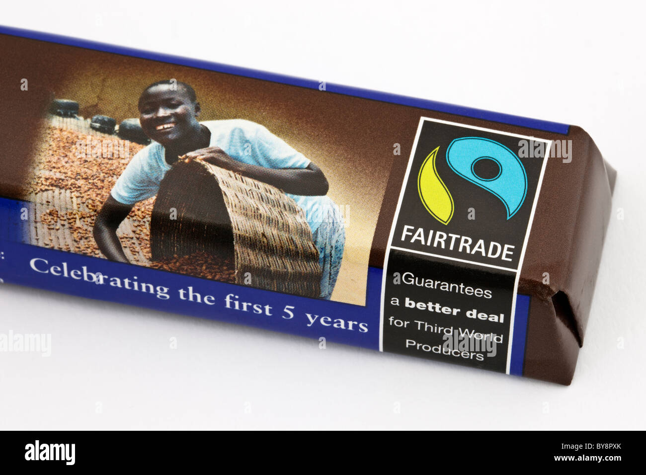 Close-up of Fairtrade chocolate bar wrapped in wrapper with fair trade logo and label. England UK Britain - Stock Image