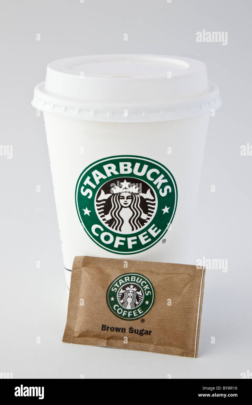 Starbucks single-use disposable paper takeaway coffee cup to go with plastic drink-through lid and one sachet of - Stock Image