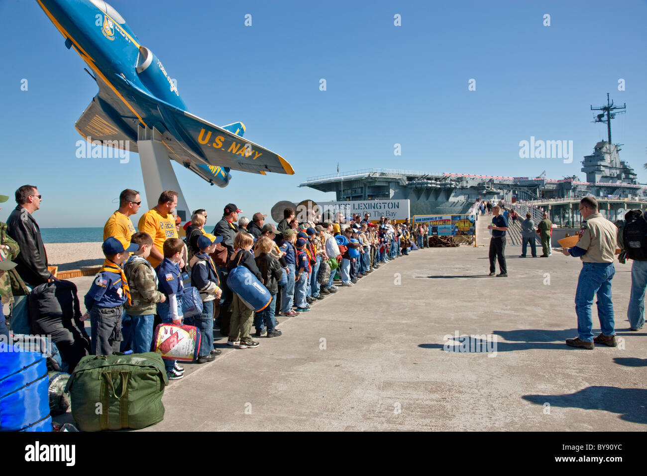 Boy & Cub Scouts with leaders waiting to board USS Lexington - Stock Image
