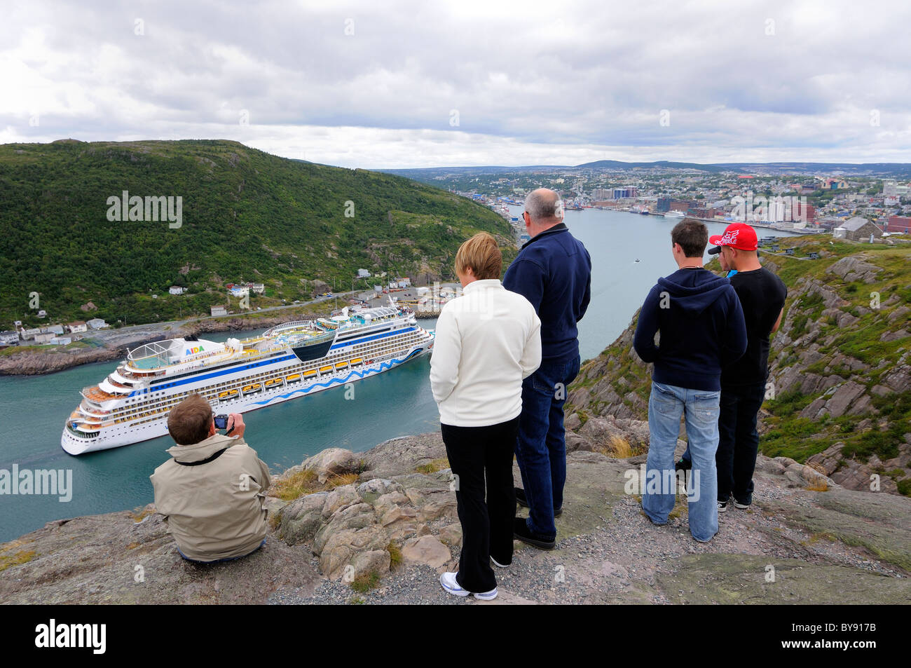 Locals And Tourist's Watching A Cruise Ship Entering St John's Stock Photo