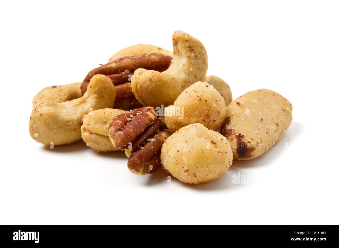 Mixed Salted Nuts from low perspective isolated on white. Stock Photo