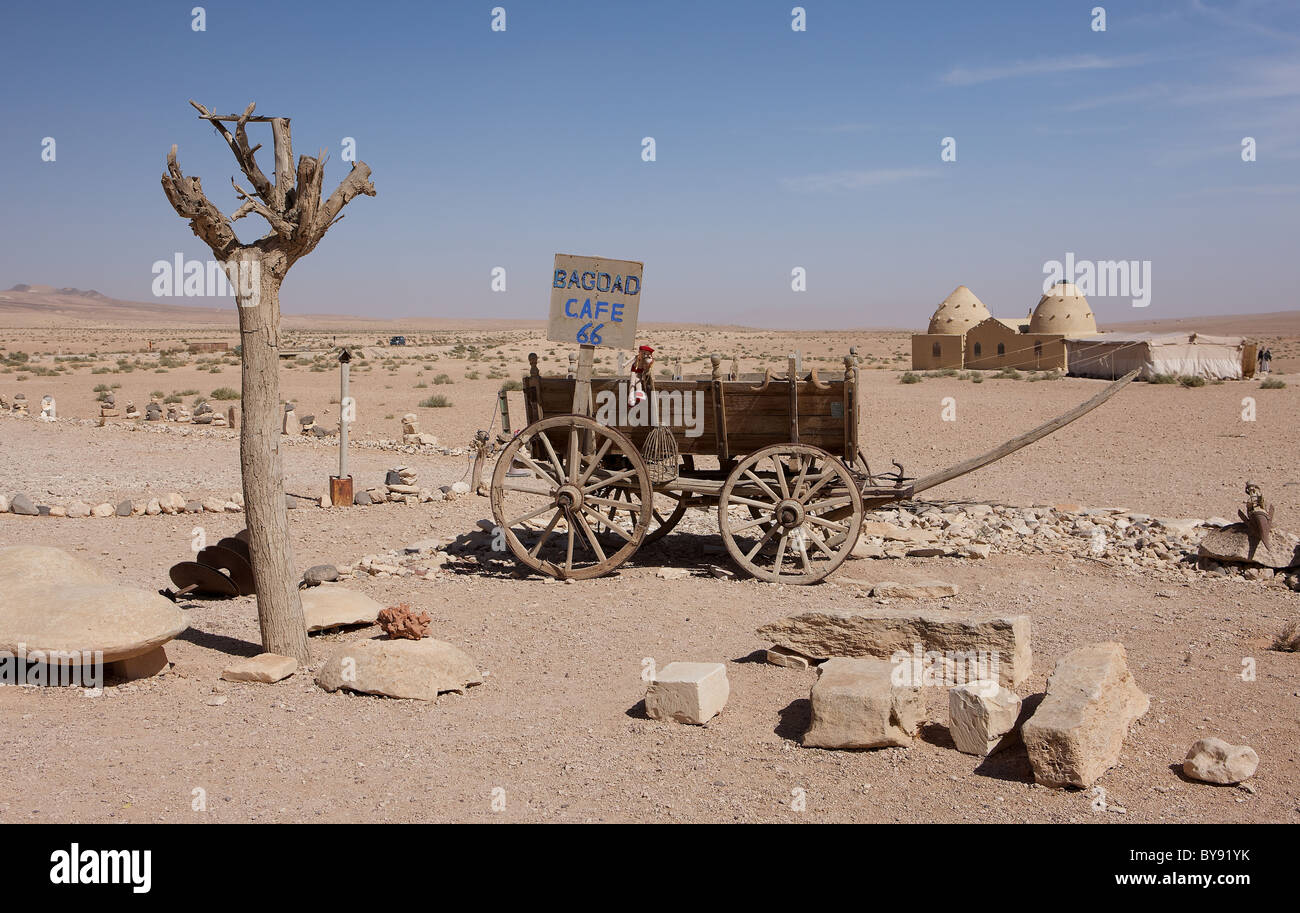 Outside the Bagdad cafe on the desert road between Damascus and Palmyra, Syria. Traditional beehive house in background - Stock Image