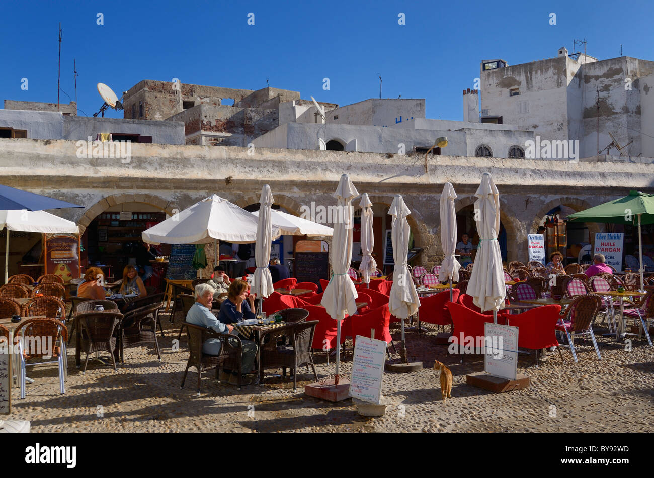 Outdoor patio cafe in a square of the medina of Essaouira Morocco - Stock Image