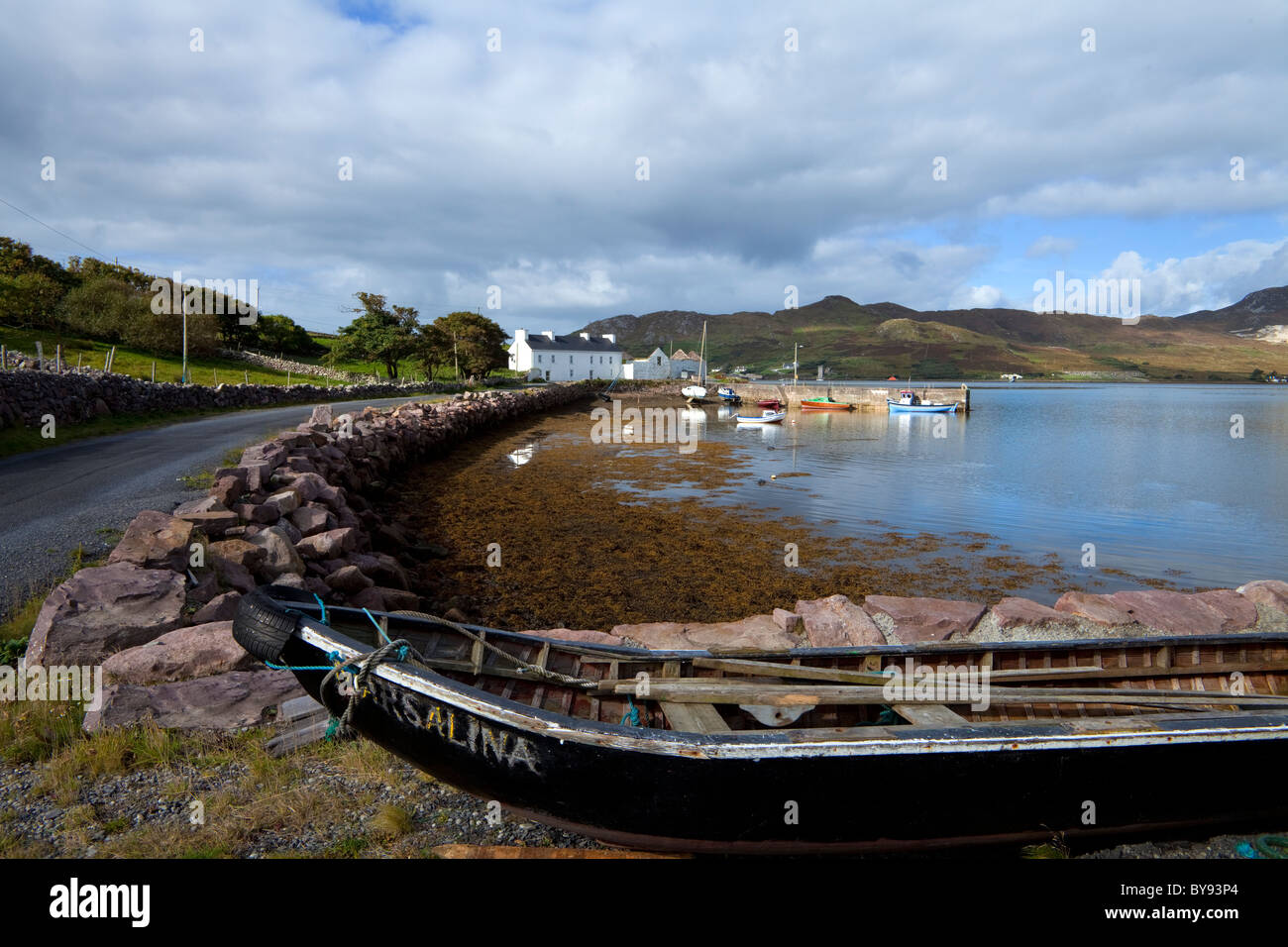 Small Fishing Harbour, with Curraghs in the Foreground, with Achill Island in the background, Corraun Peninsula, - Stock Image