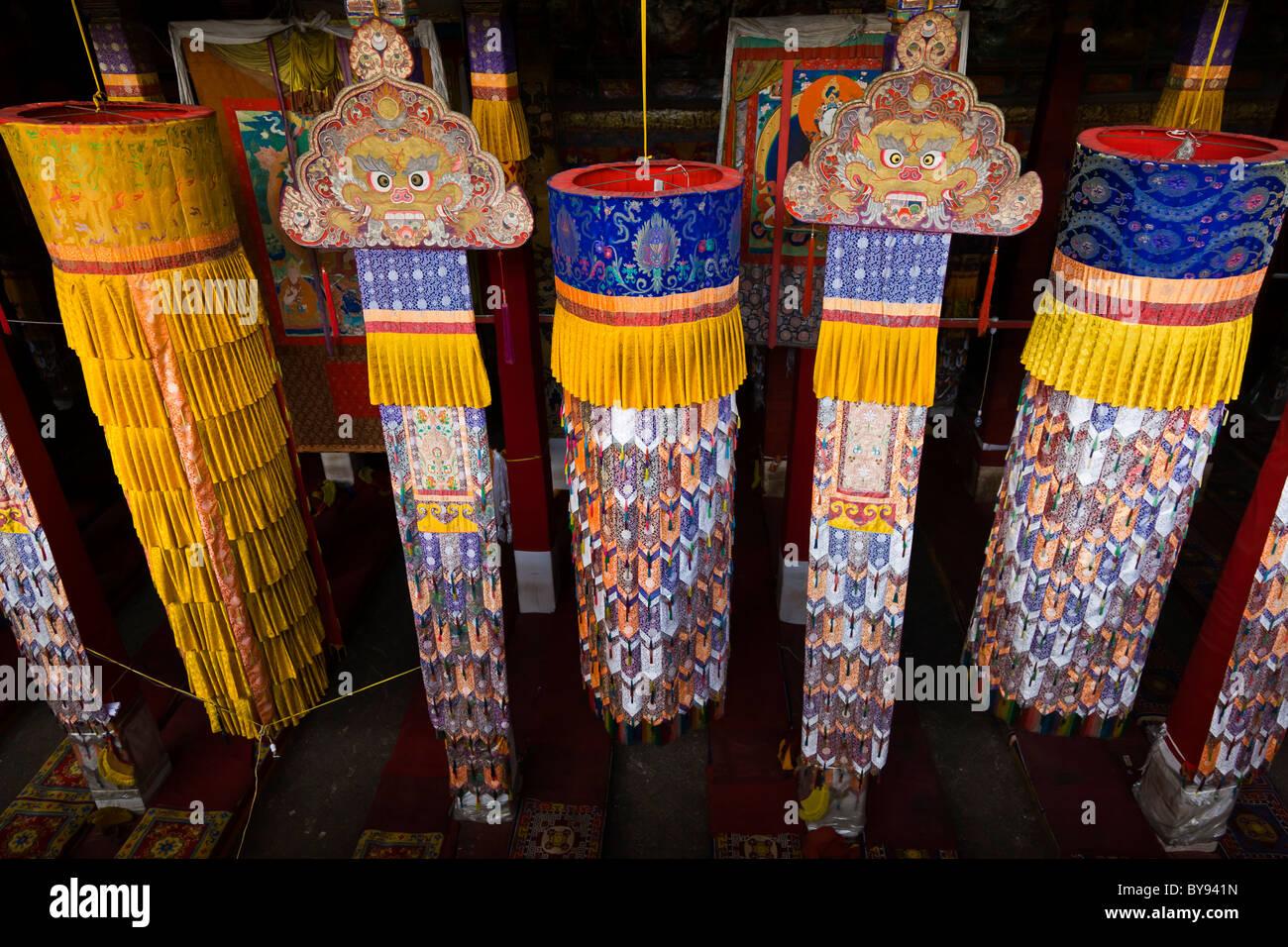 Hanging decorations in the Prayer Hall at Drepung Monastery, Lhasa, Tibet. JMH4548 - Stock Image