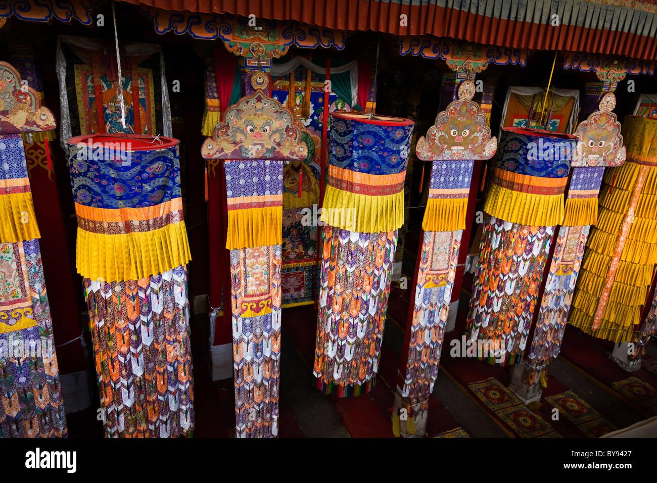 Hanging decorations in the Prayer Hall at Drepung Monastery, Lhasa, Tibet. JMH4549 - Stock Image
