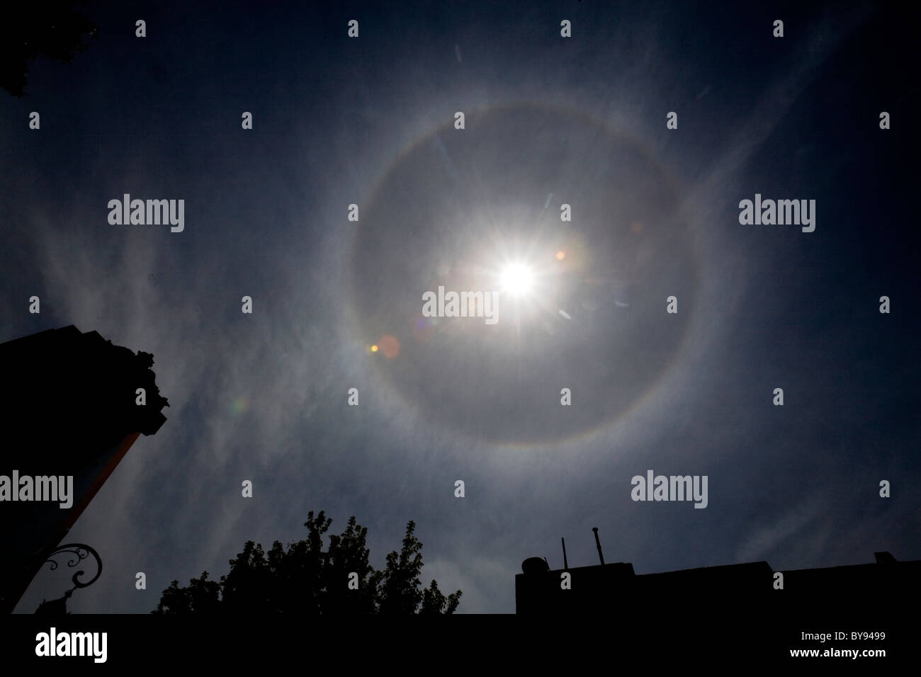 Solar halo in cirrostratus clouds over Buenos Aires, Argentina. - Stock Image