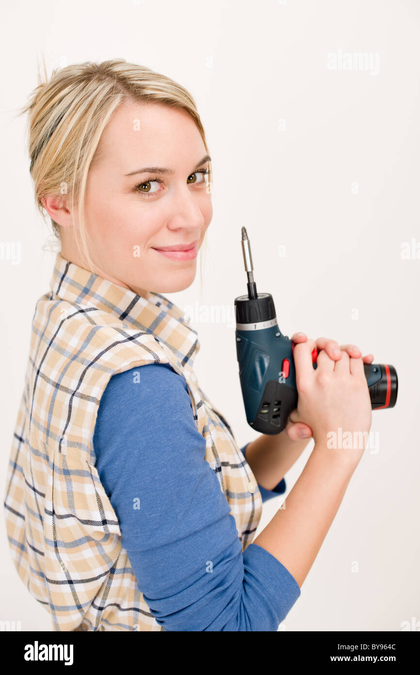 Home improvement - woman with battery cordless screwdriver - Stock Image