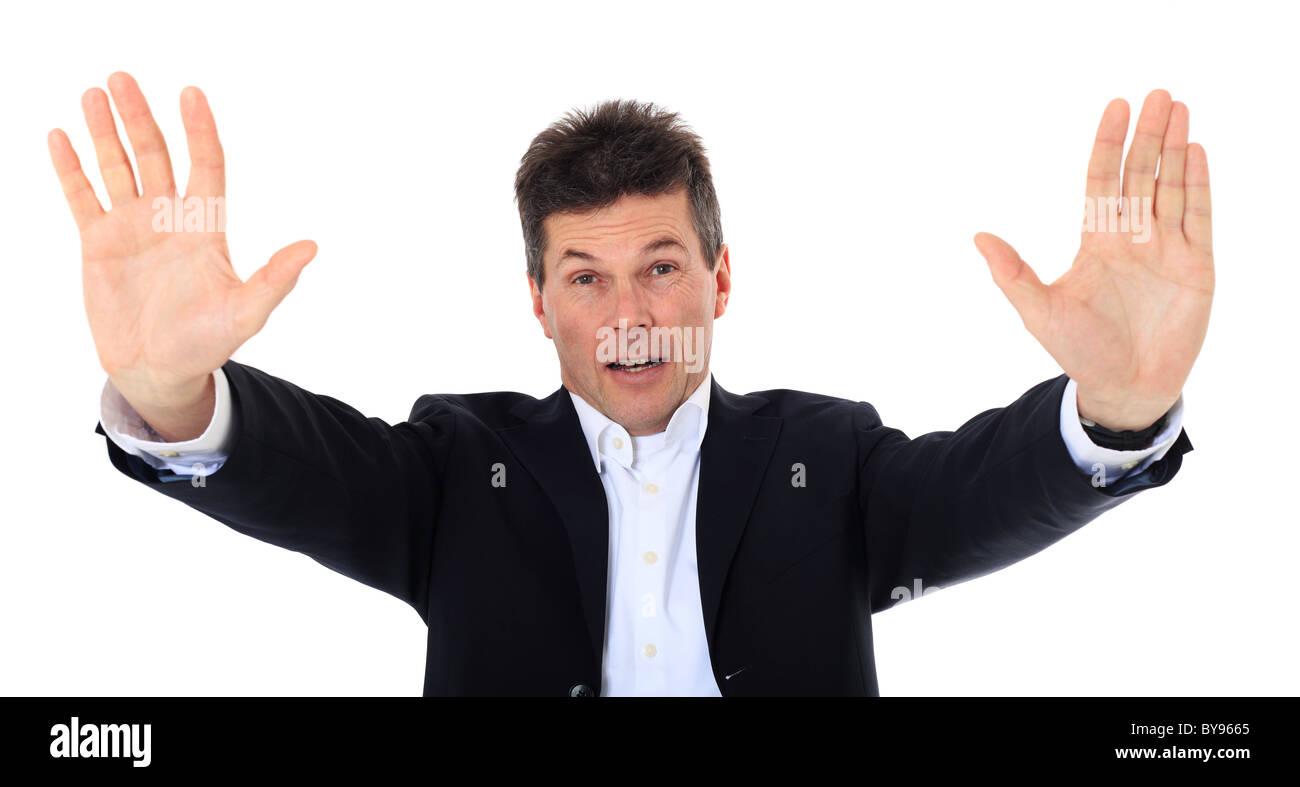Attractive middle-aged man making repelling gesture. All on white background. - Stock Image