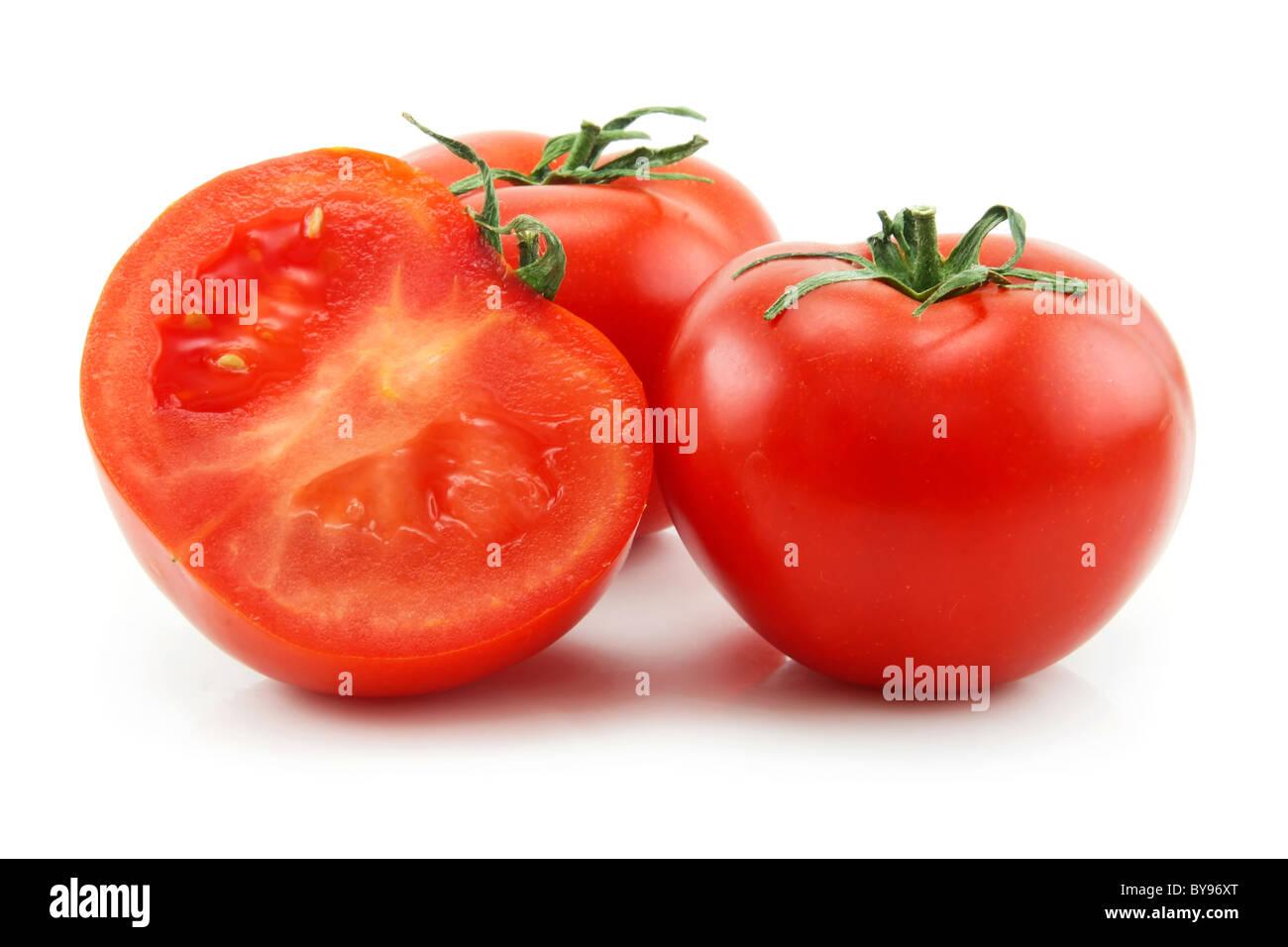 Ripe Sliced Tomatoes Isolated on White - Stock Image
