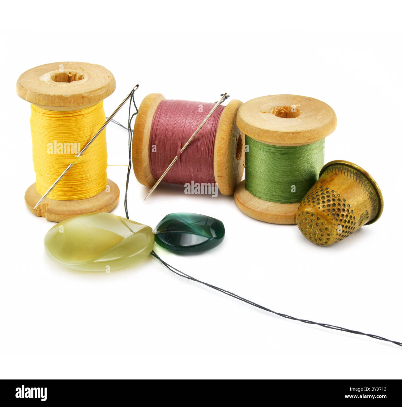 Spool of thread, thimble and needle - Stock Image