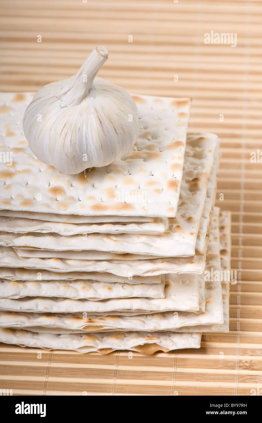Many dried matza or matzah bread slices - Stock Image