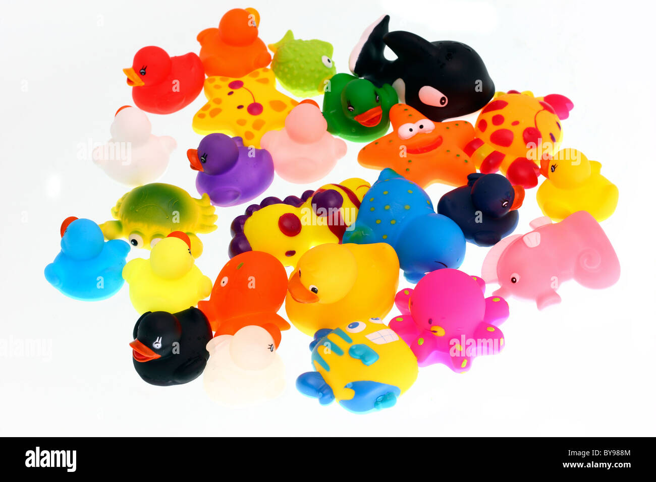 Bath toys, different colorful figures for kids to play with in a pool or bath tub. Wind-up figures, mechanic. Stock Photo