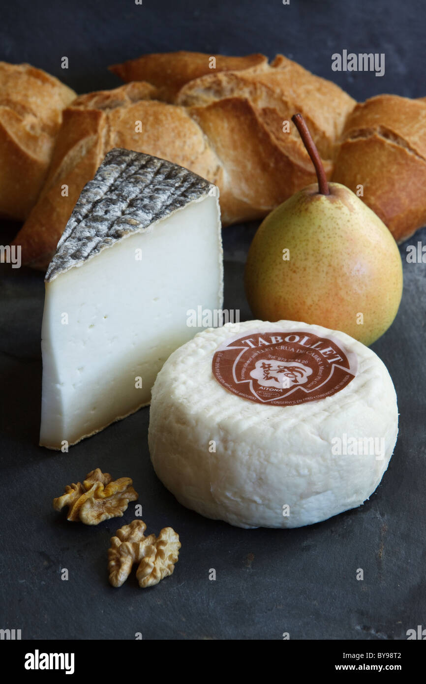 Goats cheese with condiments. Tabollet and Montllobe from artisan producer Formatge Montllobé in Aitona, Catalonia, - Stock Image