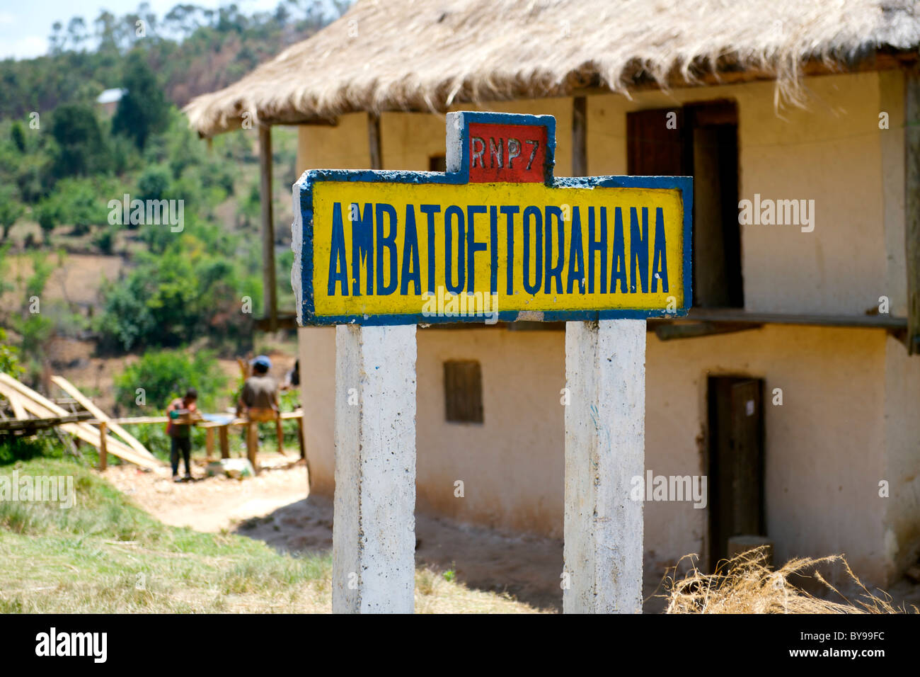 Road sign for the village of Ambatofitorahana on the RN7 road in southern Madagascar. - Stock Image