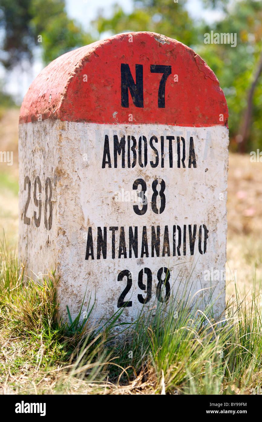 Milestone for Ambositra and Antananarivo on the N7 road in Madagascar. - Stock Image