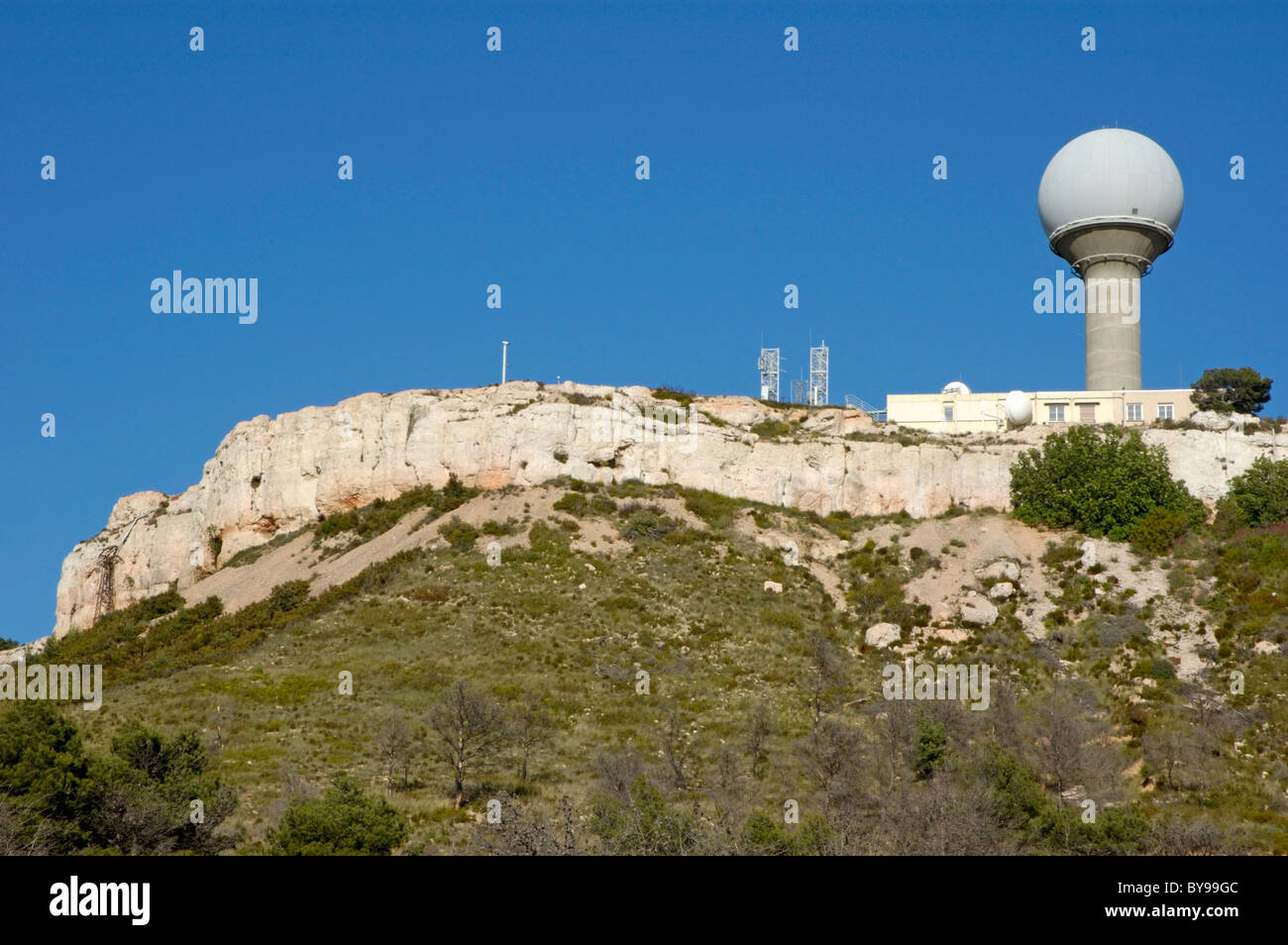 Meteorological station dome on a cliff top, Vitrolles, Provence, France. - Stock Image